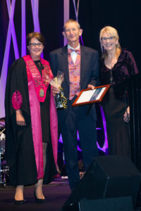 Hans receiving award from President Caroline Robertson at NZVA Conference,