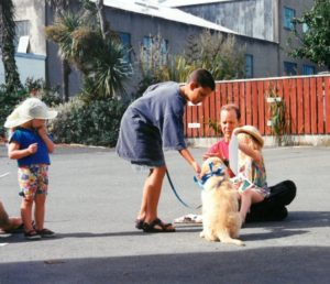 Duncan (with daughter Evangeline on lap) leads an early Puppy Preschool class